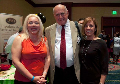 Dr. McKenzie with John Schaffner and his wife at the annual taste of Buckhead Luncheon