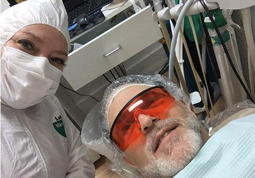 Dr. McKenzie with Patient, ready to go Mercury Free, pre-hazmat